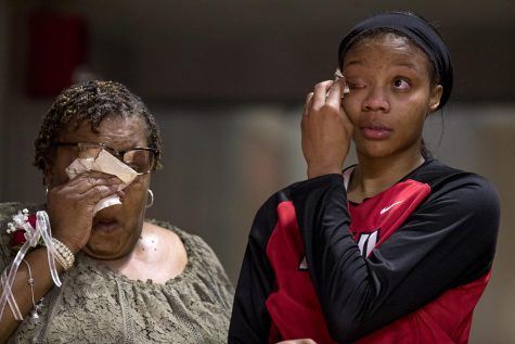WKU forward Tashia Brown (10) and her mother Tomekia Thomas wipe away tears as they listen to coach Michelle Clark-Heard following the Lady Toppers 83-61 win over University of North Carolina at Charlotte on Friday Feb. 23, 2018 at Diddle Arena. In her four years on the team Brown has scored 1961 points and averaging 15.2 points per game.