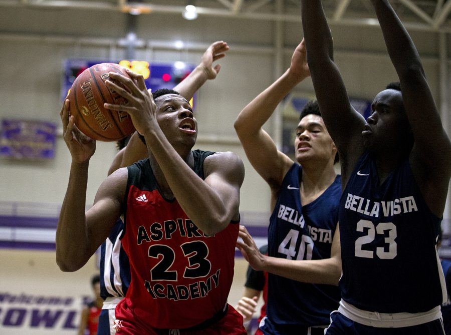 Charles Bassey (23) looks to score after getting a rebound during a tournament at Bowling Green High School, on Feb. 3, 2018. Bassey played for Aspire Academy, and committed to WKU on June 13. He re-classified to the 2018 class, and will play this fall for the Hilltoppers.