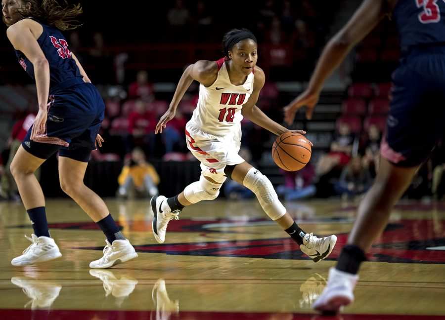 WKU+Forward+Tashia+Brown+%2810%29+drives+the+ball+during+the+Lady+Toppers+82-63+win+over+Florida+Atlantic+on+Feb.+3+at+Diddle+Arena.+Brown+lead+the+team+in+scoring+with+25+points.