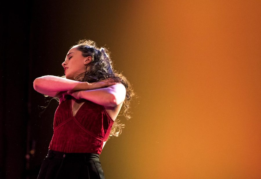 Senior+dance+major+Hannah+McCarthy+performs+her+solo+piece+that+she+choreographed+for+the+show.+This+piece+is+part+of+her+thesis%2C+which+is+a+study+of+feminism+in+modern+dance+history.+%22It+is+the+first+time+I%27ve+truthfully+expressed+feelings+about+some+of+the+hardest+moments+of+my+life+on+stage%2C%22+McCarthy+said.
