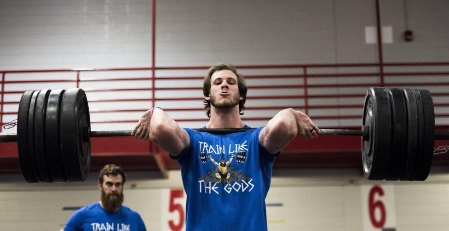 Parker Teeter lifts a barbell during the CrossFit for Cures competition at Preston Health and Activities Center on Feb. 3. Teeter has been doing crossfit for 3 years, and came to the competition from Nashville, TN with his team