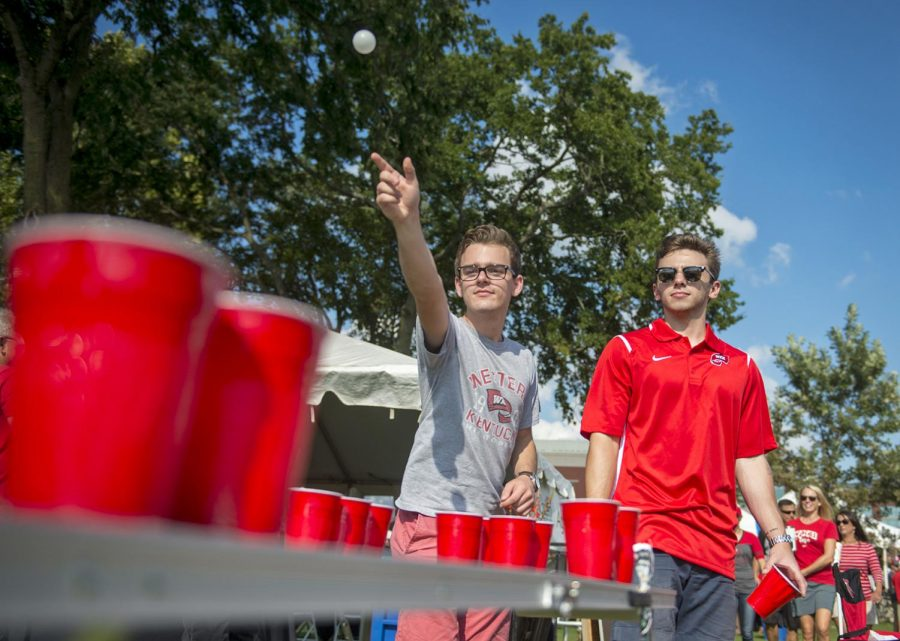 Senior Corey Graham and junior Josh Rickert play beer pong on south lawn during tailgating before WKU's homecoming game on October 14.
