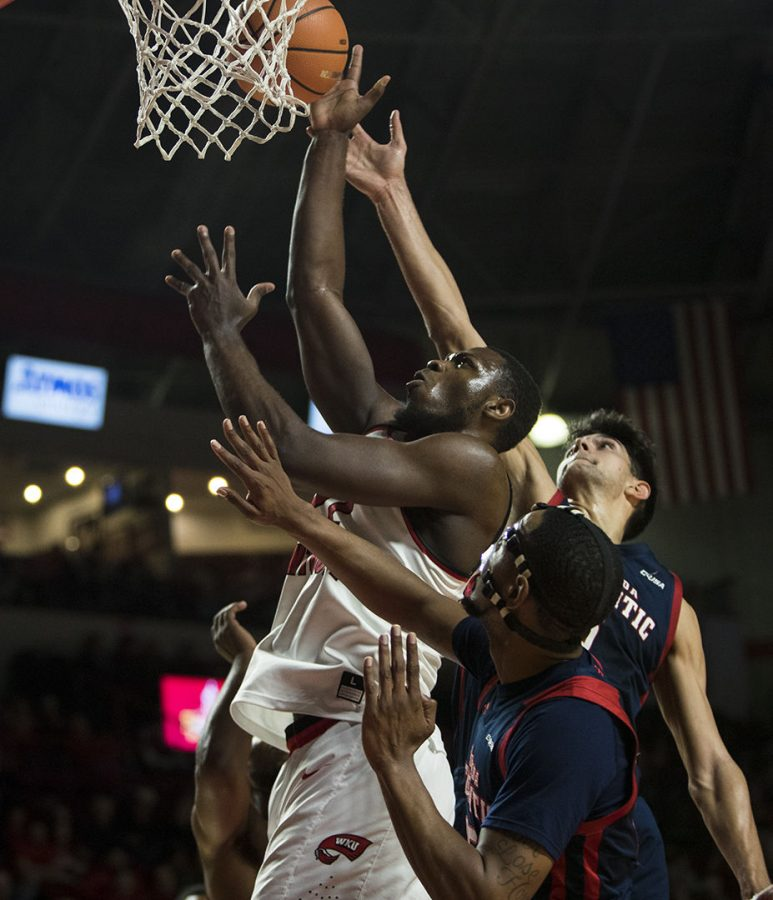 WKU+forward+Dwight+Coleby+%2822%29+reaches+for+a+rebound+during+WKUs+game+vs.+Florida+Atlantic+in+E.A.+Diddle+Arena+on+Feb.+8.+Coleby+scored+15+points+and+had+8+rebounds.
