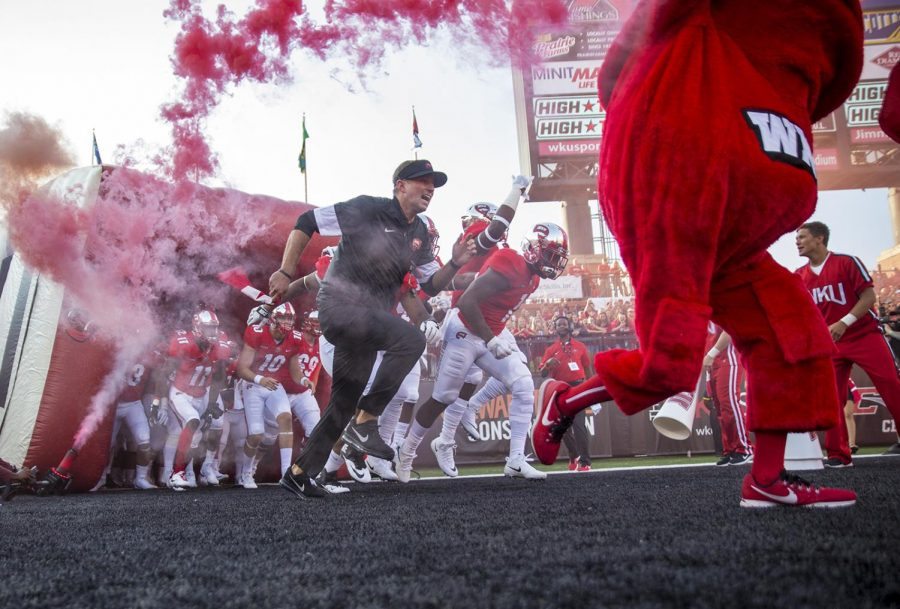 Head coach Mike Sanford leads the team out of the tunnel at the start of the first half of the WKU - EKU football game on Saturday, Sept. 2 at Houchens-Smith Stadium.