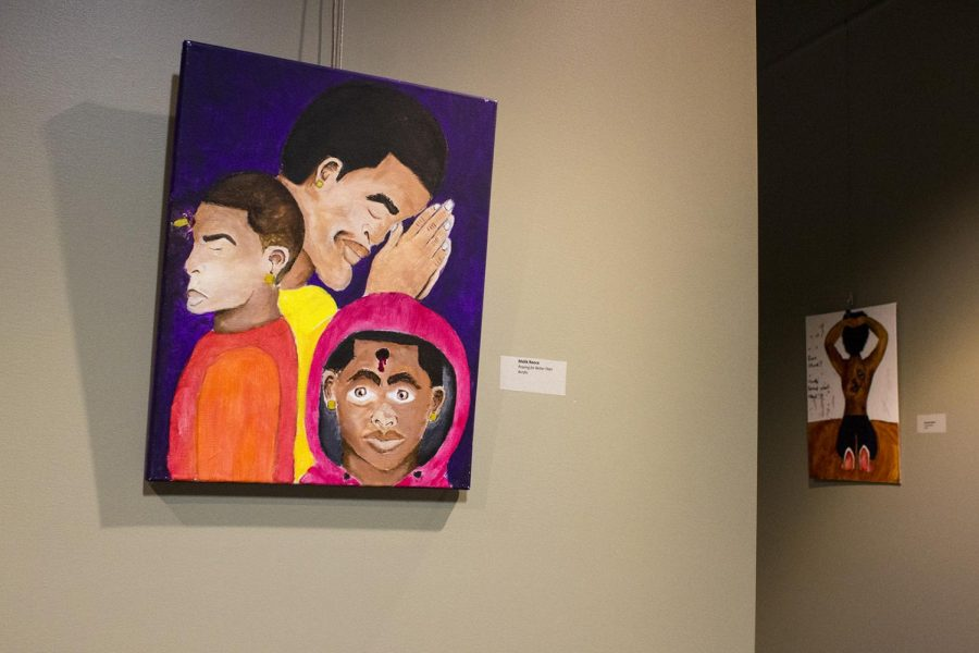 Art hangs for a Black History Month gallery in room 2041 of DSU. The event, sponsored by the Intercultural Student Engagement Center, features artwork from WKU students Malik Reece, Darinda Reddick and Shayne Howell. The gallery will be available to view throughout the remainder of this month and the first week of March.
