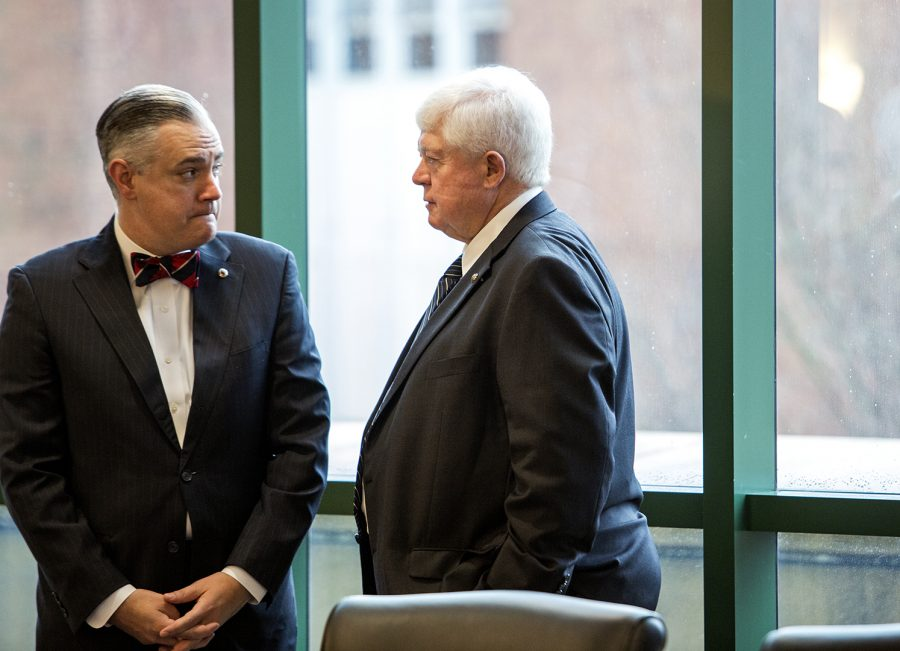 President Timothy Caboni speaks to Regent Frederick A. Higdon before the Board of Regents meeting on Feb. 23 in Jody Richards Hall. The main discussion of the meeting was the university's current budget deficit and the plan for the future.