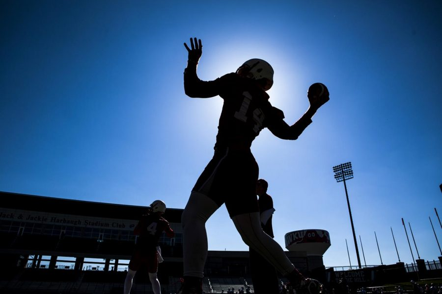 WKU+quarterback+Mike+White+%2814%29+warms+up+before+WKU+football+team+spring+practices+on+Tuesday+April+12%2C+2016+at+L.T.+Smith+Stadium+in+Bowling+Green%2C+Ky.+Shaban+Athuman%2FHERALD