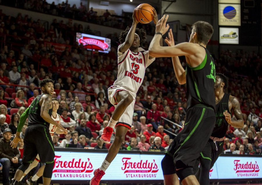 Taveion+Hollingsworth%2C+WKU+guard%2C+goes+up+for+a+shot+against+Marshall+University.+WKU+won+with+a+final+score+of+85+to+74.