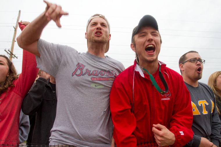 Louisville senior Troy Davis and Louisville freshman Hunter Heath celebrate after Delta Tau Delta wins Tug on April 29, 2013, at the WKU Ag Farm.