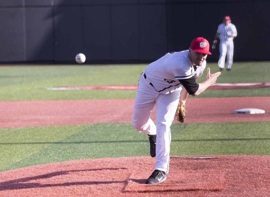 Pitcher Michael Martin throws a pitch on March 21 at 4:00 pm at Nick Denes Field. The WKU Hilltoppers baseball team took on the Louisville Cardinals. The final score was 5-8.