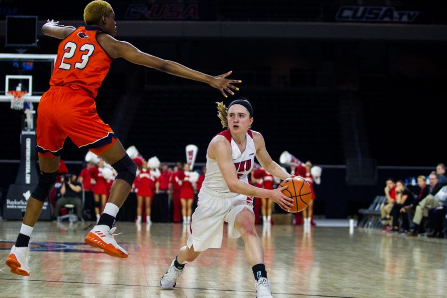 WKU+Guard+Whitney+Creech+%285%29+looks+to+make+a+pass+against+UTEP+Forward+Tija%C2%A0Hawkins+%2823%29+during+the+Lady+Toppers+78-50+win+in+first+game+of+the+Conference+USA+tournament+against+University+of+Texas+at+San+Antonio+on+Thursday+March+8%2C+2018+at+The+Star+in+Frisco%2C+Tx.+Creech+had+4+steals+in+the+Lady+Toppers+win.