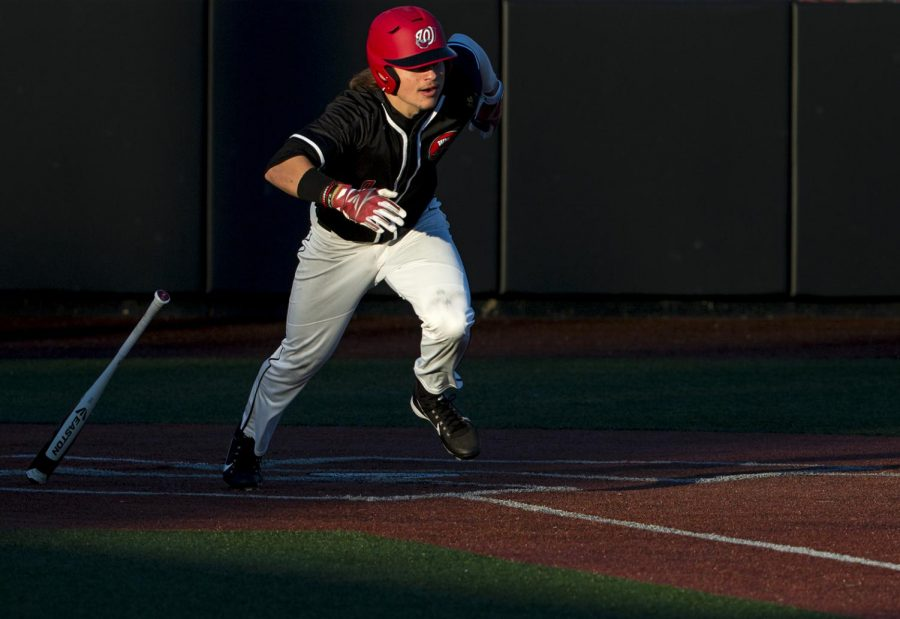 Junior outfielder Jacob Rhinesmith (2) runs to first base after hitting during the first of three games against West Virginia University on March 2 at Nick Denes Field.
