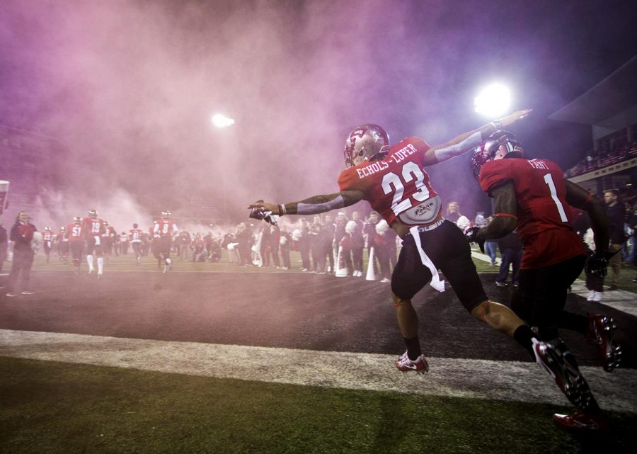 WKU wide receivers Cameron Echols-Luper (23) and Nacarius Fant (1) take the field before their game vs MTSU on Friday Nov 17, 2017 in L.T. Smith Stadium.