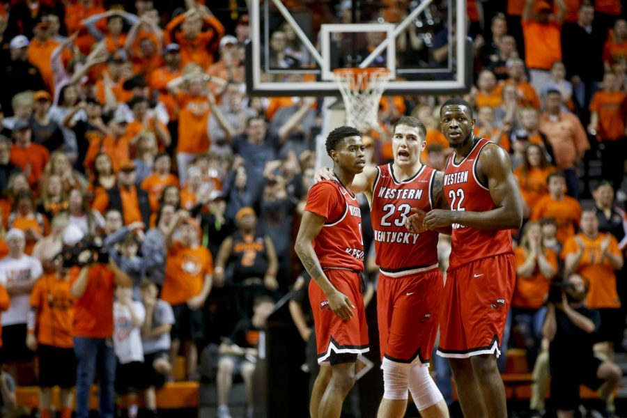 WKU guard Lamonte Bearden (1), forwards Justin Johnson (23) and Dwight Coleby (22) talk after a foul during the NIT quarterfinal game between the Oklahoma State Cowboys and the Hilltoppers at Gallagher-Iba Arena in Stillwater, Okla. on Wednesday, March 21st.