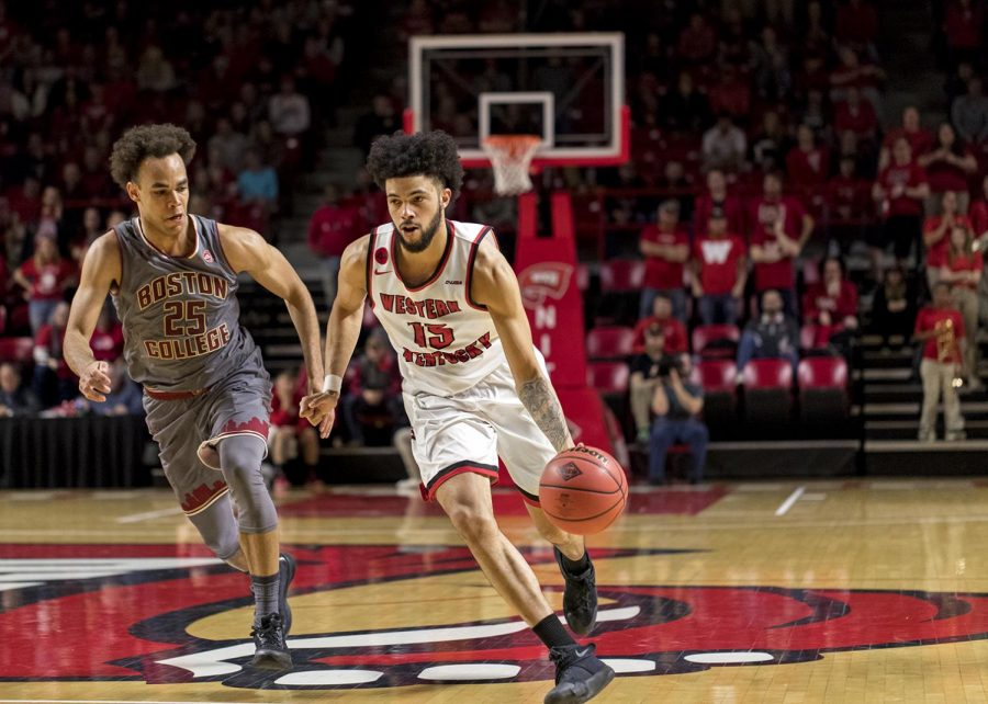 WKU+senior+guard+Darius+Thompson+%2815%29+is+guarded+by+Boston+College+player+Matt+DiLuccio+%2822%29+during+the+first+round+of+the+NIT+basketball+tournament.+WKU+beats+Boston+College+79-62+on+March+13+in+Diddle+Arena+.