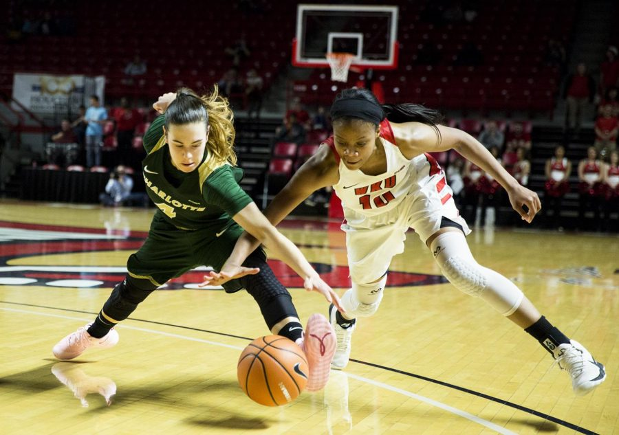 Senior forward Tashia Brown (10) fights for the ball against Charlotte 49ers junior guard Laia Raventós (4) during the WKU Lady Toppers senior night on Feb. 23 at Diddle Arena. The Lady Toppers won 83 to 61.