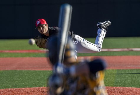 Graduate student Ryan Thurston (20) pitches during the first of three games against West Virginia University on March 2 at Nick Denes Field. The Toppers lost 5-7 to WVU.