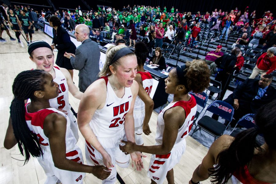WKU+Forward+Ivy+Brown+%2823%29+celebrate+with+her+team+following+their+77-61+win+in+the+semifinal+game+of+the+Conference+USA+tournament+against+University+of+North+Texas+on+Friday+March+9%2C+2018+at+The+Star+in+Frisco%2C+Tx.