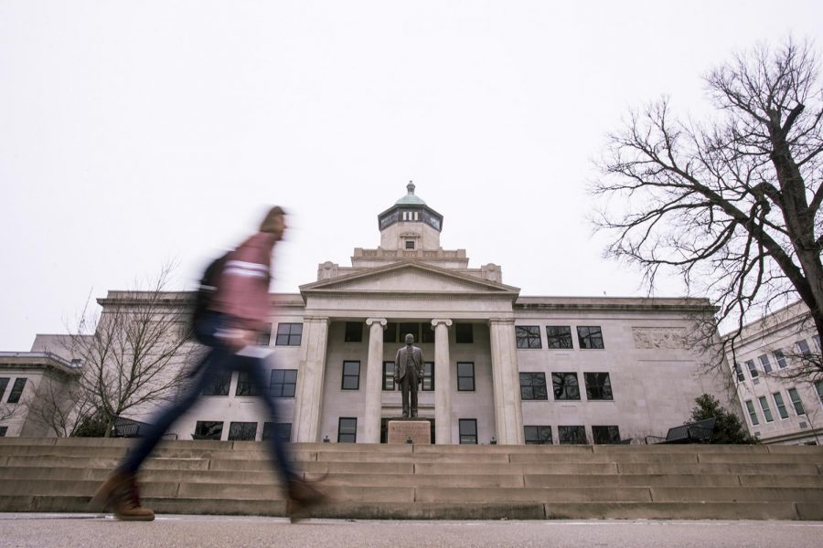 A student walks in front of Cherry Hall on Feb. 22.