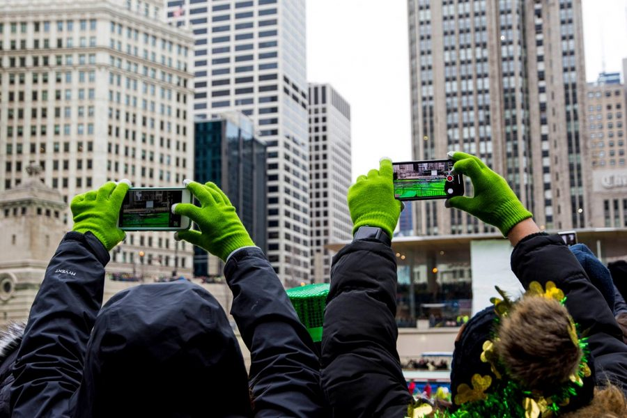 Thousands+gather+along+the+Chicago+River+on+St.+Patrick%E2%80%99s+Day+2018+to+watch+it+be+dyed+green.+The+dyeing+of+the+river+dates+back+to+1962.