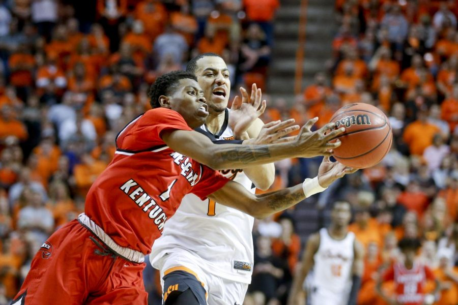WKU guard Lamonte Bearden (1) and Oklahoma State Cowboys guard Kendall Smith (1) battle for a loose ball during NIT quarterfinal game between the Oklahoma State Cowboys and the Hilltoppers at Gallagher-Iba Arena in Stillwater, Okla. on Wednesday, March 21st, 2018.