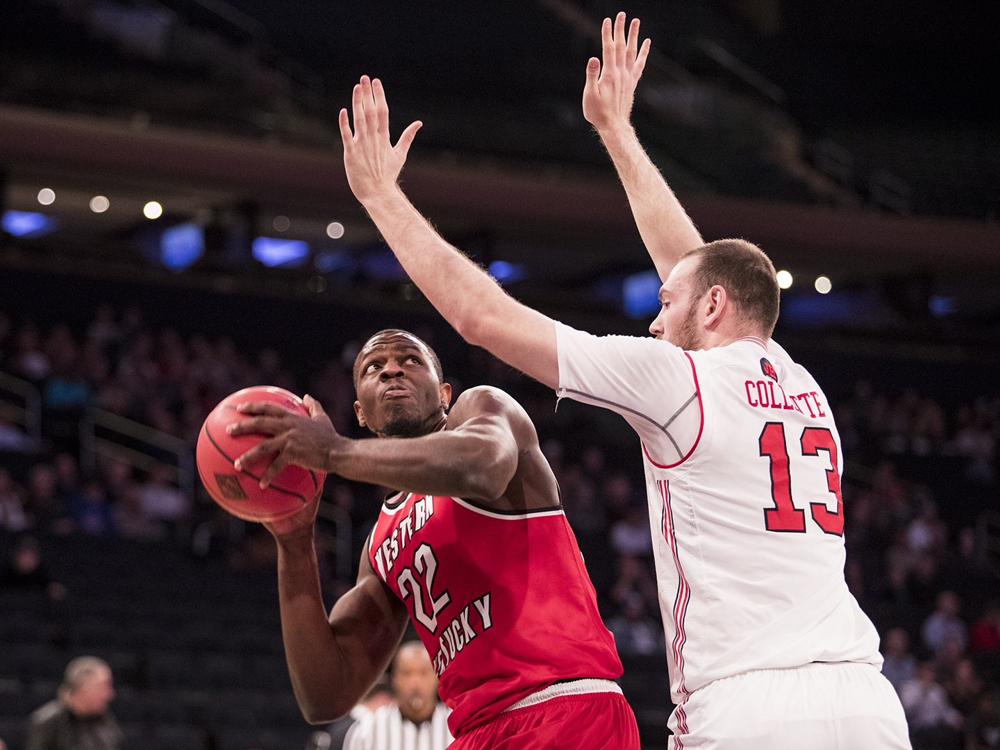 WKU forward Dwight Coleby is defended by Utah's forward David Collette during the semifinals of the NIT Championship in Madison Square Garden on March 27. WKU lost 69-64.
