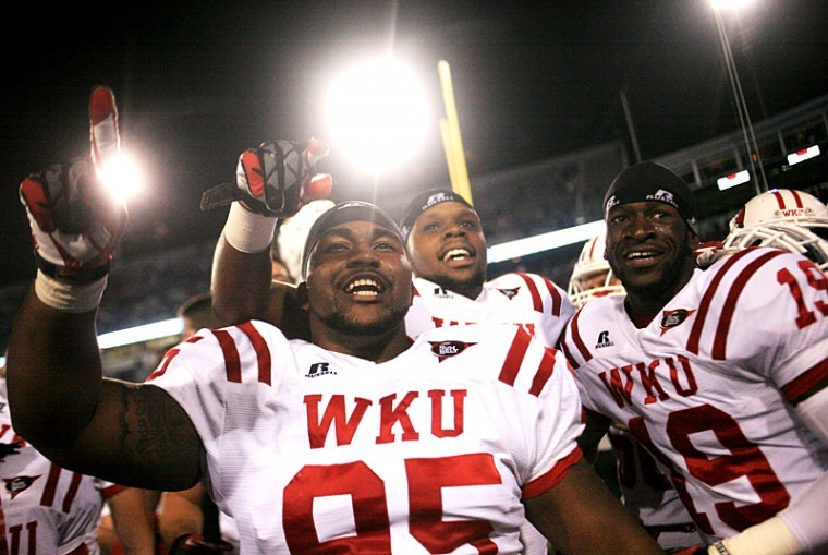 WKU+defensive+lineman+Kenny+Martin+celebrates+with+teammates+after+winning+the+WKU-UK+game+at+Commonwealth+Stadium+in+Lexington+on+Saturday%2C+Sept.+15%2C+2012+with+a+score+of+32-31+in+overtime.%C2%A0
