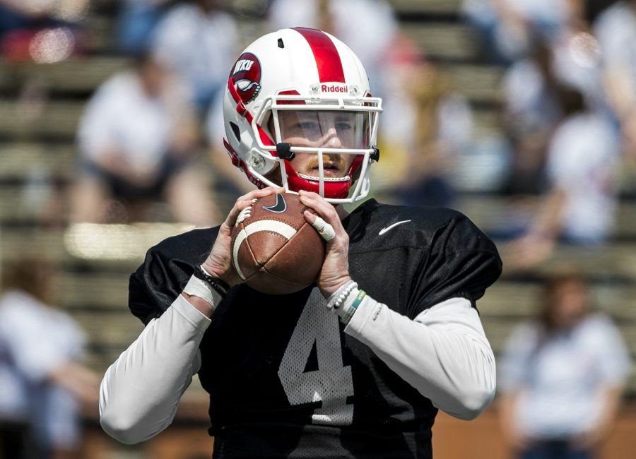 Redshirt+senior+quarterback+Drew+Eckels+%284%29+throws+a+pass+while+warming+up+at+the+preseason+spring+football+game+in+L.T.+Smith+Stadium+on+Saturday.
