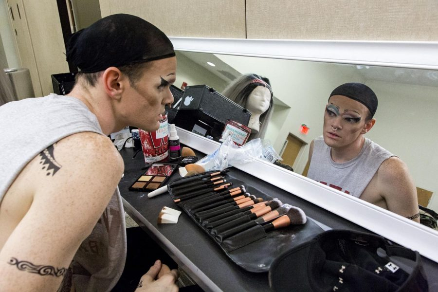 Travis Lizer puts on makeup before the annual Housing and Residence Life drag show on April 5 at the Sloan Convention Center. Lizer goes by