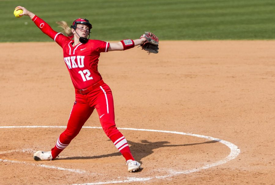 Sophomore+pitcher+Kelsey+Aikey+%2812%29+winds+up+for+a+pitch+during+the+first+game+of+a+double+header+against+Eastern+Kentucky+University+on+April+11+at+the+WKU+Softball+Complex.+The+Lady+Toppers+defeated+EKU+6-3+in+the+first+game+and+lost+4-8+in+the+second.