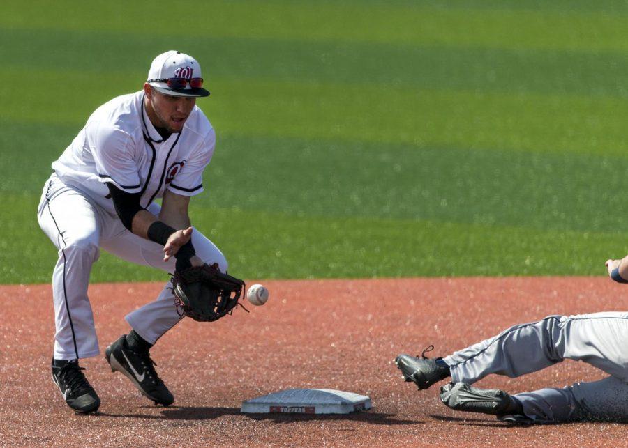 Second baseman Steven Kraft (1) tries to catch a throw from catcher Colin Butkiewicz (9) during WKUs baseball game vs. UTSA on March 31 at Nick Denes Field. WKU defeated UTSA 9-5.