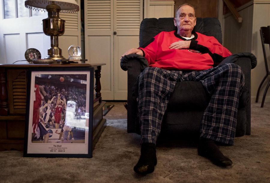 Life-long WKU fan Roger Osborne, 80, watches WKU play Utah in the NIT semifinals on March 27 with his family at his home in Bowling Green. Osborne was diagnosed with terminal cancer earlier this year and has been spending quality time with the people he loves while also supporting the team he loves.