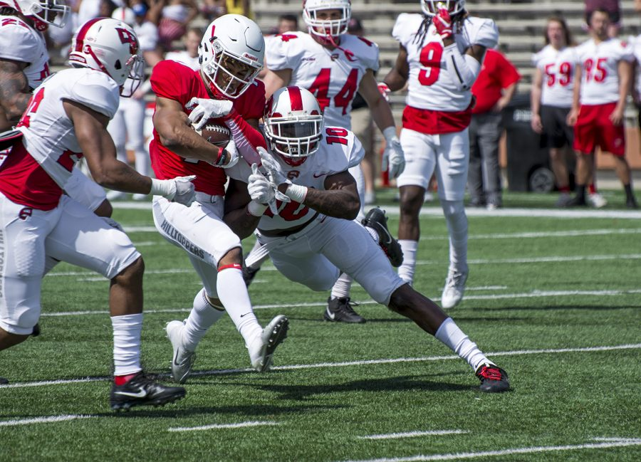 Sophomore defensive lineman DeAngelo Malone (10) brings down the ball carrier during the spring game at L.T. Smith Stadium on April 21.