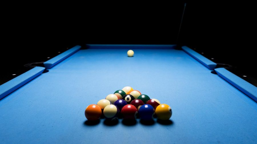 Billiard balls sit racked on the table at Cue Time pool hall in Bowling Green on April 19. Nicole Hall-Rochester, co-owner of Cue Time, wanted to create a bar where games like darts and pool were in the forefront.