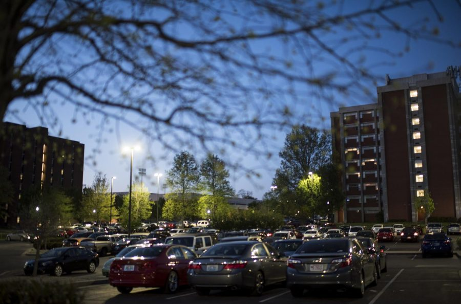 Cars sit in the Pearce Ford Tower lot on Thursday night. Freshman Lauren Hammer said that her permit has helped her this semester and plans on getting one again despite the price change.