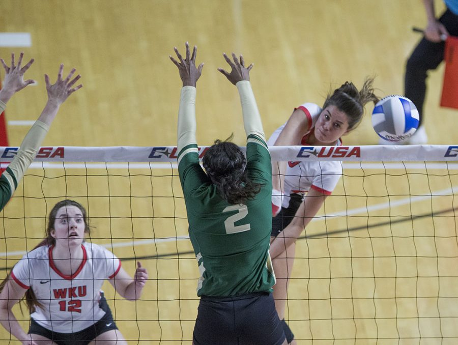 WKU outside hitter Alyssa Cavanaugh (7) spike the ball for a kill against Charlotte Nov 17 during the Conference USA championship held in Diddle Arena.