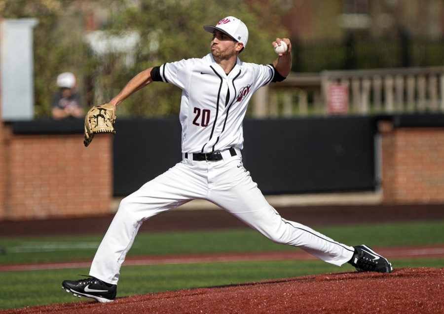 Graduate+student+left+handed+pitcher+Ryan+Thurston+%2820%29+throws+a+pitch+during+the+first+game+of+a+double+header+against+Marshall+on+April+13+at+Nick+Denes+Field.+WKU+lost+to+Marshall+6-5%2C+but+came+back+and+won+6-2+in+the+second+game.