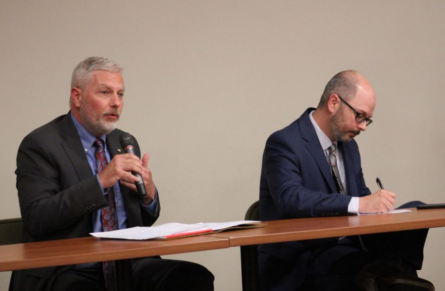 David Brinkley (left) answers a question during an open forum with the candidates for the staff regent position. The candidates included Brinkley, Greg Hackbarth (right) and Robert Unseld (not shown), and they talked their platforms and ideas about staff-related issues, including retention, retirement and leave policies.