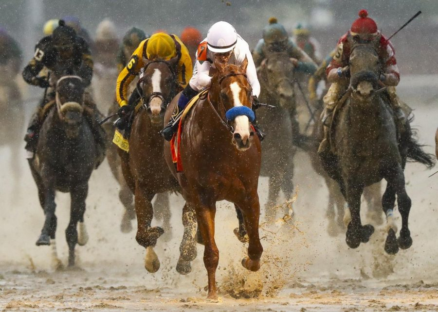 Justify with Mike Smith up, center, after winning the 144th running of the Kentucky Derby Saturday at Churchill Downs. Good Magic with Jose Ortiz up, left, finished second and Audible with Javier Castellano up finished third.