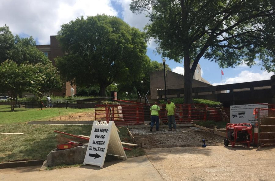 Part of the sidewalk leading up to the Fine Arts Center walkway near Potter Hall is being replaced due to sections of failed underground steam piping and the site demolition required to access the piping.