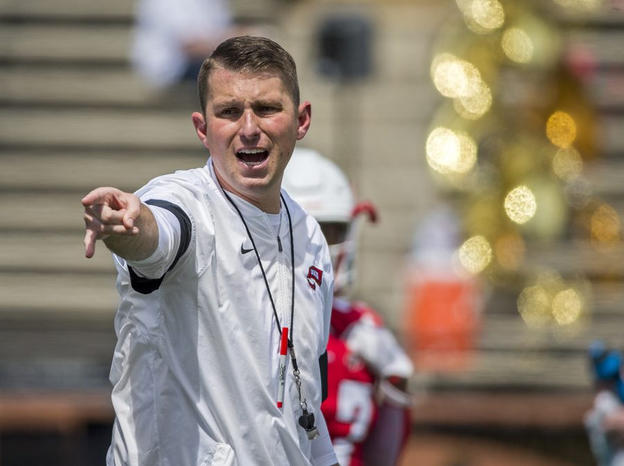 """WKU head football head coach Mike Sanford calls instructions to players as they warm up before the Red vs. White game in Houchens-Smith Stadium on Saturday, April 21. """"This is just the beginning of our journey,"""" Sanford said after the game."""