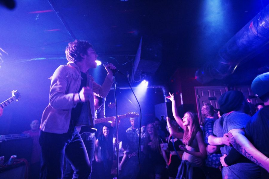 Lead singer Matthew Shultz (left) performs in front of a packed crowd with his band Cage the Elephant at Rocky's Thursday, Jan. 30, 2014, in Bowling Green, Ky.(Mike Clark/HERALD)