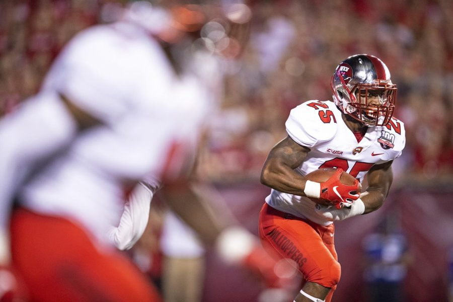 Western+Kentucky+Hilltoppers+running+back+Joshua+Samuel+%2825%29+is+handed+the+ball+in+the+first+quarter+during+the+NCAA+football+game+between+the+Western+Kentucky+Hilltoppers+and+Wisconsin+Badgers+at+Camp+Randall+Stadium+on+August+31.%C2%A0
