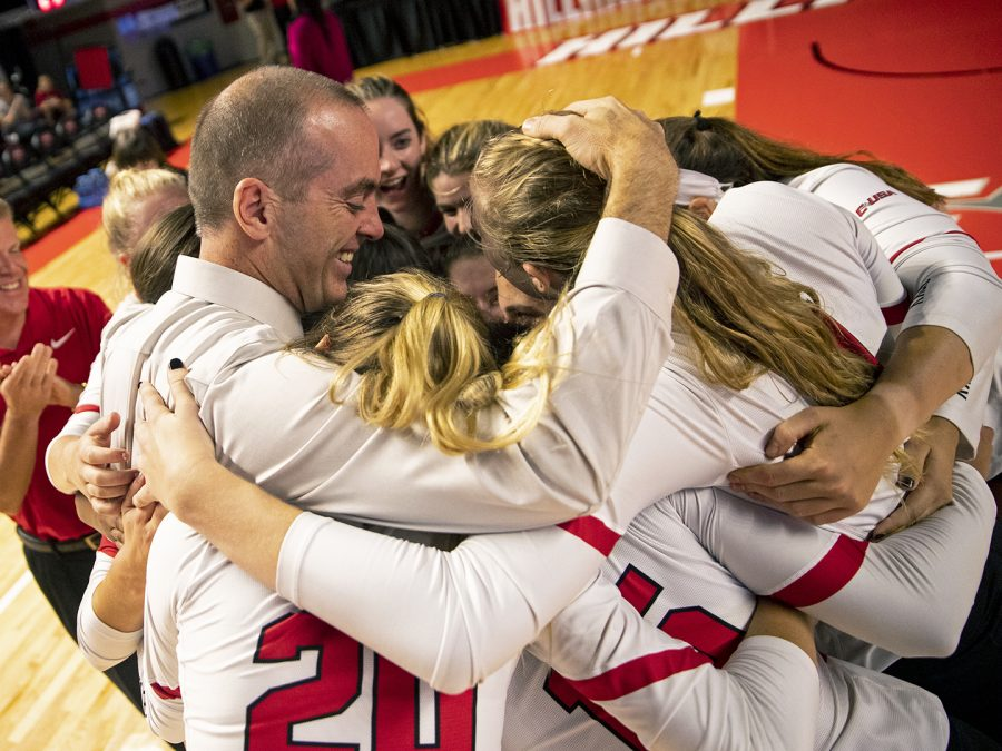 WKU head coach Travis Hudson embraces his team after beating Middle Tennessee 3-0 to give Hudson his 600th career win in E.A. Diddle Arena on Friday, Sept. 21, 2018.
