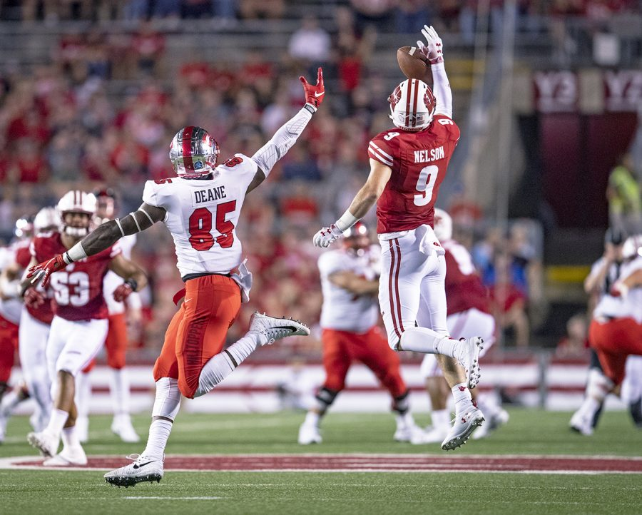 Wisconsin safety Scott Nelson (9) blocks a pass to Western Kentucky tight end Mik'Quan Deane (85) at Camp Randall Stadium on August 31.