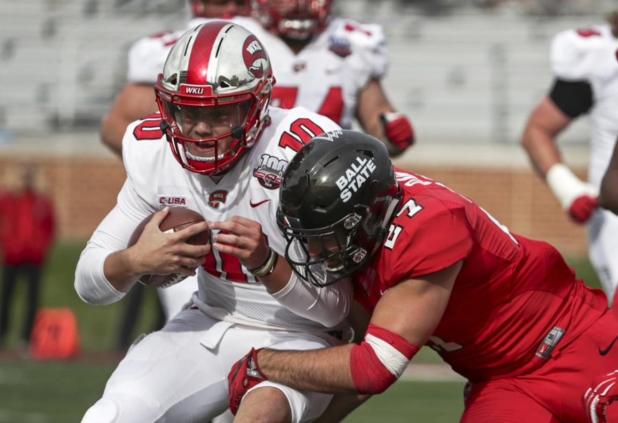 Quarterback Steven Duncan (10) is tackled while rushing by linebacker Jimmy Daw (27) at Scheumann Stadium on Saturday, Spet. 22, 2018. Duncan rushed for 55 yards in the game.