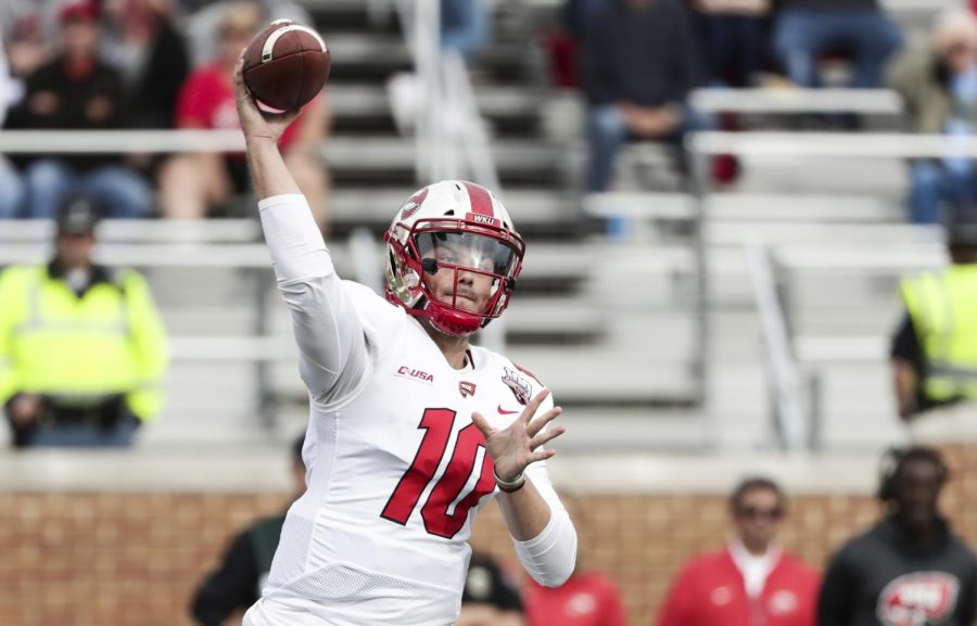 Steven+Duncan+throws+a+pass+in+WKU%27s+game+against+Ball+State+on+Saturday.+The+Hilltopper+quarterback+had+94+passing+yards+and+55+rushing+yards+in+the+28-20+win.%C2%A0