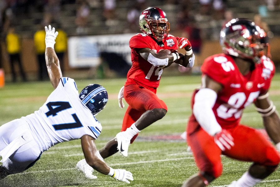WKU%E2%80%99s+Garland+LaFrance+%2814%29+dodges+a+tackle+during+WKU%27s+game+against+Maine+at+Houchens+Industries+-+L.T.+Smith+Stadium+in+Bowling+Green+on+Saturday%2C+Sept.+8%2C+2018.+%28Mike+Clark+%2F+Herald%29
