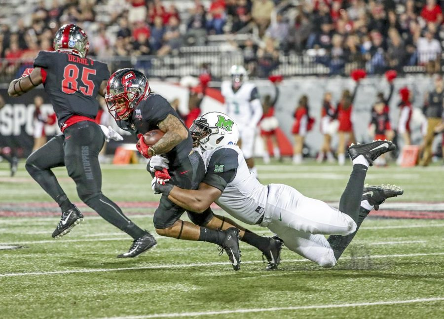 WKU wide receiverJacquez Sloan (2) runs with the ball while defended by Marshall wide receiver Donquell Green (4) during WKU's 17-20 lost to Marshall on Saturday, Sept. 29, 2018 at Houchens L.T. Smith Stadium