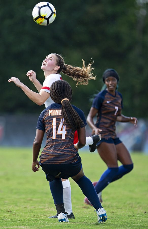 WKU sophomore Victoria Mayo (3) heads the ball as she is defended by UTEP junior defender Kori Lewis (14) during a Lady Topper 4-3 victory game against University of Texas at El Paso on Sunday, October 7, at WKU Soccer Complex.